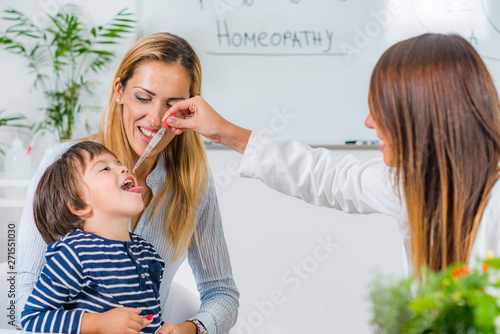 Photo  Homeopathy. Mother and little boy visiting a homeopath