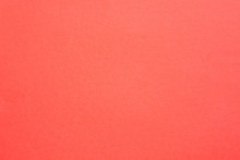 Coral Red Felt Texture Abstract Art Background. Solid Color Carton Surface. Empty Space.