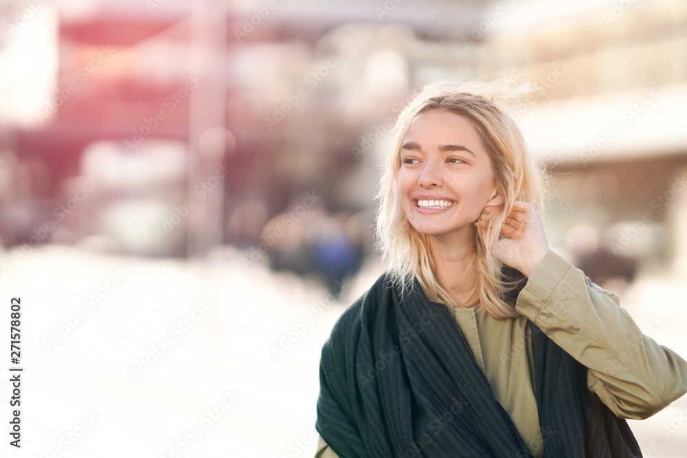 Fototapeta Cheerful young woman in the city
