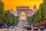 Fototapeta Fototapety Paryż - Champs Elysees and the Arc de Triomphe During a Golden Sunset
