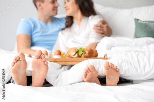 Fototapeta Cute young couple having breakfast in bed obraz