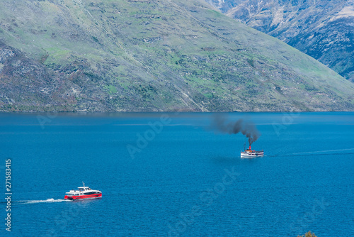 Recess Fitting Blue Steamboat sails on lake Wakatipu, Queenstown, New Zealand. Copy space for text.