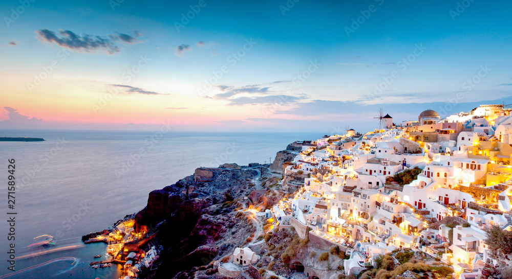 Fototapeta impressive evening view of Santorini island. Picturesque spring sunset on the famous Greek resort Oia, Greece, Europe. Traveling concept background.