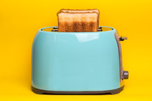 Cyan Color Toaster On A Yellow...