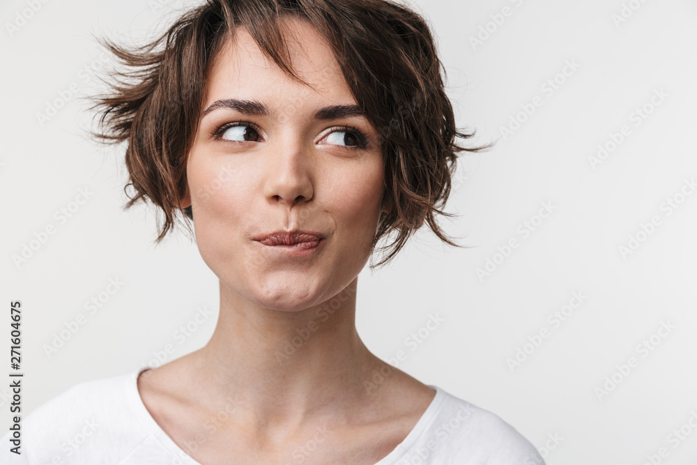 Fototapety, obrazy: Beautiful young pretty thinking thoughtful woman posing isolated over white wall background.