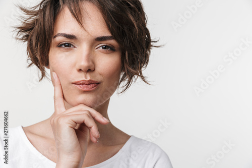 Beautiful young pretty thinking thoughtful woman posing isolated over white wall background Fototapet