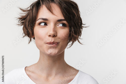 Photo  Beautiful young pretty thinking thoughtful woman posing isolated over white wall background