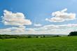 Leinwandbild Motiv Grüne Wiese im Sommer in Frankreich