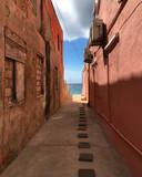 Fototapeta Uliczki - Corridor between two pink houses leading to the ocean