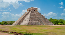 Great Mayan Pyramid Of Kukulkan, Known As El Castillo, Classified As Structure 5B18, Taken In The Archaeological Area Of Chichen Itza, Between Trees And Sky, In The Yucatan Peninsula