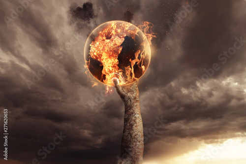 stone hand holding burning earth and rise up in the apocalyptic sky Fototapet