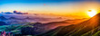 canvas print picture Setting Sun over Mountains and Valley