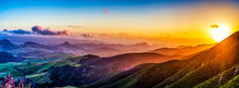 Setting Sun Over Mountains And Valley