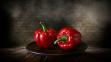 Red Pepper On A Wooden Table, Dark Room, Dark Background