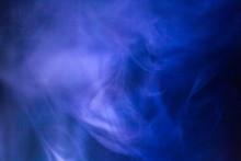 Blue And Purple Smoke Texture At Industry And Chemistry Concept , Detection Poison And Toxic Gas In Factory . Condensation Swirl Steam In The Air .