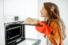 Beautiful Young Woman Baking B...