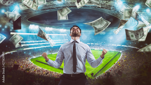 Man who rejoices at the stadium for winning a rich soccer bet Canvas Print