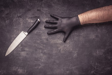 Male Hands With Black Latex Gloves And Knife On Dark Background