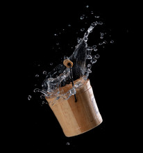 Wooden Bucket With Water Splas...