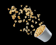 Popcorn Flying Out Of The Package Isolated On Black Background