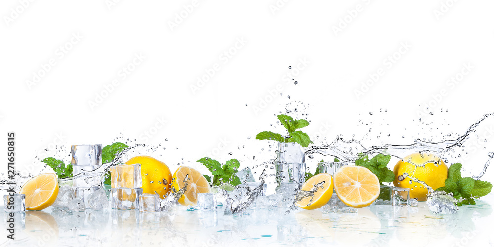 Fototapeta ice cubes, mint leaves with lemons isolated on a white background