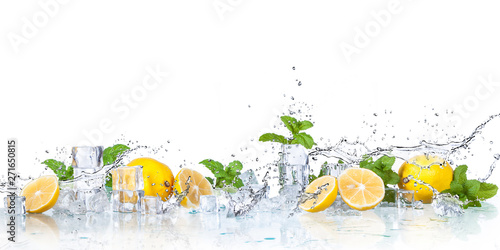 Fototapeta ice cubes, mint leaves with lemons isolated on a white background obraz