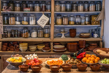 Ancient Village Cottage Cellar With Bottles Of Spices, Bowls Of Healthy Natural Vegetables And Juicy Ripe Fruits