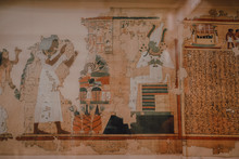 Cairo, Egypt - April, 12 2019: Crumbling Ancient Mural And Hieroglyphs On Wall Of Entombment