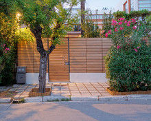 Contemporary House Entrance Fence And Door Late In The  Evening