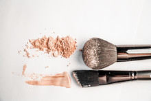 Powder Slide, A Touch Of Foundation And Two Black Makeup Brushes