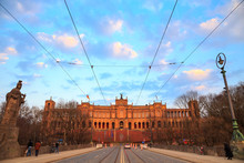 Maximilianeum Is An Old Historical Palace In Munich, Germany Built 1874. Which Houses The Bavarian Landtag (state Parliament). At Sunset, Under Purple Clouds And Blue Sky.