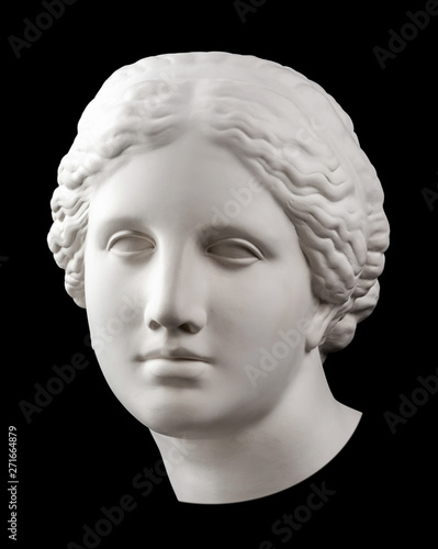 Foto  Gypsum copy of ancient statue Venus head isolated on black background