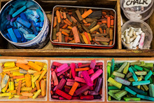 Overhead View Of Varieties Of Crayons In Containers