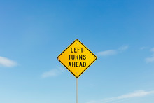 Left Turns Ahead Yelloow Traffic Sign,Left Turns Ahead Sign, Blue Sky In Background