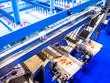 Leinwanddruck Bild - Food industry. Conveyor for processing sea products. Shrimp conveyor. Shock freezing shrimp. Production of frozen semi-finished products.