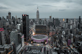 Fototapeta Nowy Jork - view from top on Madison Square Garden and Empire State Building. Night Lights