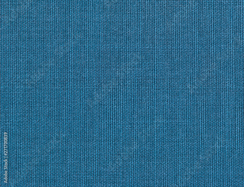 Textured background of blue natural textile