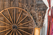 A Horizontal Photo Of A Old Wagon Wheel And Some Pussy Willows