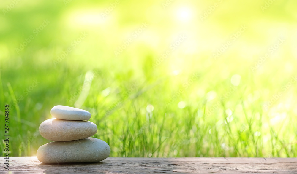 Fototapety, obrazy: Stack of zen stones on abstract nature green summer background. Relax still life with stacked of stone. zen pebble stones, spa wellness tranquil scene, soul equanimity calmnes concept. copy space
