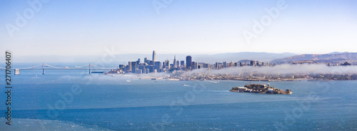 Panoramic view of San Francisco's skyline and Alcatraz Island on a sunny day, California