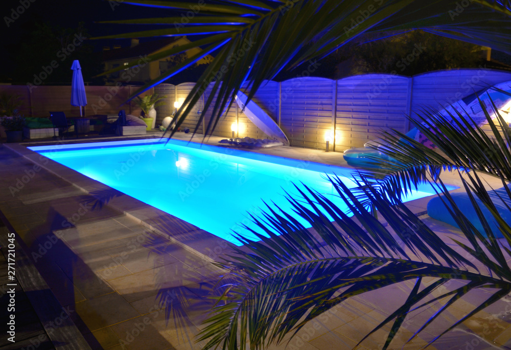 Fototapety, obrazy: water of swimming pool illuminated in blue by night