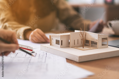Group of an architect working and discussing about an architecture model togethe Canvas Print