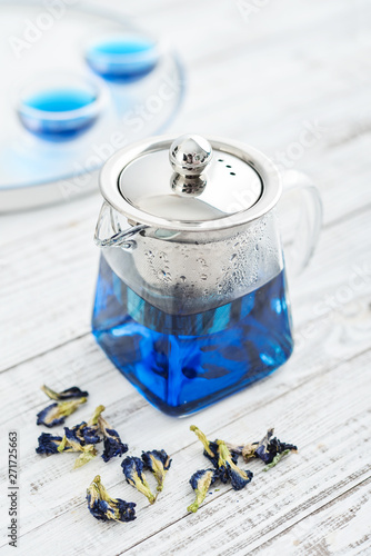 Glass teapot with blue Anchan tea Canvas Print