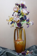 Bouquet Of Yellow Brown Flowers Of Iris In A Clay Vase Amphora On Coffee Background