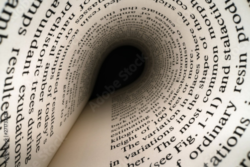 Fototapety, obrazy: Inside the book concept. Latin letters and words on an tunnel shaped, perspective book page with black dramatic light. Education, knowledge concept