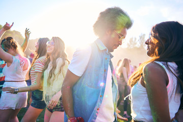 Enthusiastic crowd dancing at music festival