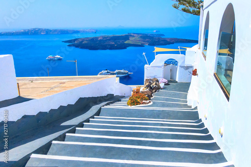 Aluminium Prints Santorini Santorini, Greece white houses architecture, hotels with caldera blue sea view and flowers blossom in famous island
