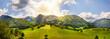 Mountain landscape with fields. Berglanschaft mit Ackerfeld im Sommer. Alpenpanorama.