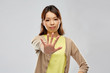 canvas print picture - people, prohibition and rejection concept - young asian woman showing stop gesture over grey background