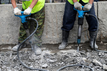 Industrial Worker Details. Male Worker Using Jackhammer Pneumatic Drill Machinery